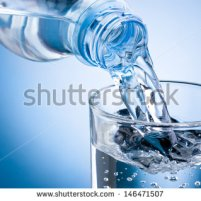 stock-photo-pouring-water-from-bottle-into-glass-on-blue-background-146471507